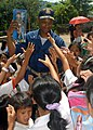 US Navy 071016-N-6710M-118 Cmdr. Todd A. Lewis, commanding officer of the USS Tortuga (LSD 46), hands out toys to the students of Gordon Heights Elementary School while conducting a community relations project in the Republic o.jpg