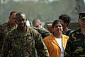 US Navy 071127-M-3095K-042 Brig. Gen. Ronald L. Bailey, commanding general of 3rd Marine Expeditionary Brigade, and Geeta Pasi, the Charge` d' Affaires from the U.S. Embassy, arrive at Barisal Airfield.jpg