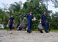 US Navy 071217-N-4774B-225 Sailors from amphibious assault ship USS Tarawa (LHA 1), guided-missile destroyer USS Hopper (DDG 70) and Marines from 11th Marine Expeditionary Unit clean trash and debris from local beaches on the i.jpg