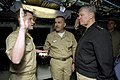 US Navy 080221-N-8273J-044 Chief of Naval Operations (CNO) Adm. Gary Roughead, right, re-enlists Chief Electronics Technician Mike Justice aboard the pre-commissioned unit (PCU) New Hampshire (SSN 778) at General Dynamics Elect.jpg
