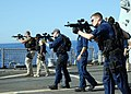 US Navy 080619-N-2838W-025 Members of the visit, board, search and seizure (VBSS) team aboard the guided-missile destroyer USS Bulkeley (DDG 84) practice essential gun-firing procedures with the MK-18 rifle.jpg