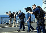 US Navy 080619-N-2838W-025 Members of the visit, board, search and seizure (VBSS) team aboard the guided-missile destroyer USS Bulkeley (DDG 84) practice essential gun-firing procedures with the MK-18 rifle