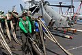 US Navy 080827-N-3610L-145 An aviation boatswain's mate assists in the stowage of a barricade net.jpg