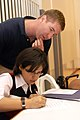 US Navy 090722-N-6185C-047 Lt. Ryan Wodele helps teach English to a student during a community service project.jpg