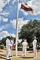 US Navy 090914-N-1783P-002 Ship's Serviceman 2nd Class Eldrin Walthall and Ship's Serviceman 3rd Class Maurice Monroe assigned to Naval Weapons Station Charleston, raise the VPP Star Worksite Flag.jpg