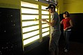 US Navy 091120-N-7014G-117 Micheal Morales and Damage Controlman 3rd Class Judy Solorio paint the inside of a classroom.jpg