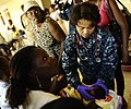 US Navy 100125-N-5345W-098 Hospital Corpsman 1st Class Vilma Bauer examines a Haitian infant at the Lifeline Christian Ministries Mission medical clinic in Grand Goave.jpg