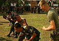 US Navy 100205-M-4689B-070 Marine Corps Cpl. Jeremy Hurlbert nstructs a Royal Thai Marine how to properly apply a non-lethal takedown move during a subject-matter expert exchange.jpg