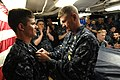 US Navy 100409-N-9818V-134 Master Chief Petty Officer of the Navy (MCPON) Rick West pins the Enlisted Submarine Warfare pin on the uniform of Electronics Technician 3rd Class Benjamin Chance.jpg