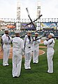 US Navy 100602-N-8848T-373 Drill team members from Training Support Center Great Lakes perform during pre-game ceremonies at the 25th annual Chicago White Sox Navy Night at U.S. Cellular Field, Chicago.jpg