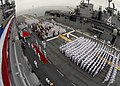 US Navy 100827-N-1805P-024 Sailors and honored guests stand at attention while the honor guard presents colors during the first change of command ceremony aboard USS Makin Island (LHD 8).jpg