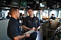 US Navy 101205-N-2943B-002 Ensign Jay English, left, and Ensign Wesley Paulk discuss Keen Sword maneuvers aboard the guided-missile cruiser USS Shi.jpg