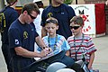 US Navy 110816-N-ZL585-157 The Leap Frogs sign autographs during Indianapolis Navy Week 2011.jpg