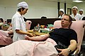 US Navy 111118-N-WV964-027 Sailors from USS Lassen donate blood while supporting flood relief efforts in Thailand.jpg