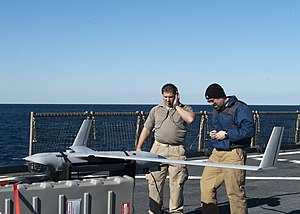 US Navy 120130-N-NR955-036 Contractors prepare the unmanned aerial vehicle Scan Eagle for take off on the flight deck aboard the Whidbey Island-cla.jpg