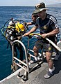 US Navy 120213-N-WX059-049 Indian navy Leading Seaman Clearance Diver 2nd Class Rajeev Kumar helps Indian navy Petty Officer Clearance Diver 1st Cl.jpg