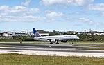 United 757-200 rocketing out of Lisbon (46832255244).jpg