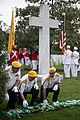 United States Military Order of the Cootie lay wreaths at the Argonne Cross in Arlington National Cemetery (30629298966).jpg