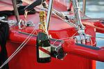 Vendée Globe 2012-2013 Tanguy de Lamotte Initiatives-cœur Essais pour le baptême du bateau (réglage de la bouteille).JPG