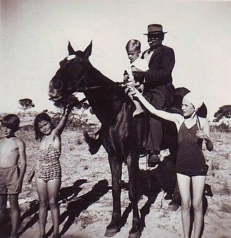 Wandi, Western Australia - Wandi holding George Atkinson, grandson of the original George Atkinson, 1947. The Atkinson family part-owned Anchorage Butchers and employed Wandi as a stockman.