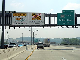 "Interstate 495 (Capital Beltway) - ""Maryland Welcomes You"" sign on the Outer Loop over the Woodrow Wilson Bridge. Well before this shoreline point, in actuality, the highway leaves Virginia at the low-water mark, briefly passes over an underwater corner of the District of Columbia, and enters Maryland for the rest of the Potomac River crossing."