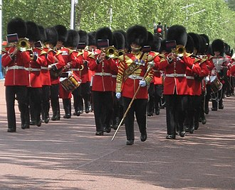 March (music) - The Band of the Welsh Guards of the British Army play as guardsmen march up the Mall to change the guard