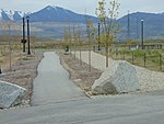 West along walkway to South Jordan Parkway station, Apr 16.jpg