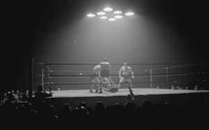 "Dusek family - Two brothers of the Dusek Family against Yvon Robert and Laurent ""Larry"" Moquin, during a tag team wrestling match, June 1945"