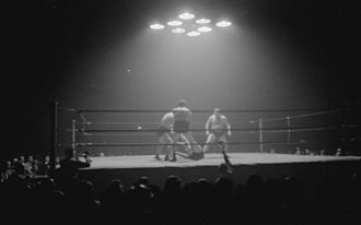 """Dusek family - Two brothers of the Dusek Family against Yvon Robert and Laurent """"Larry"""" Moquin, during a tag team wrestling match, June 1945"""