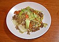 Yakisoba (fried noodles) with pork, onions, cabbage and carrot.jpg