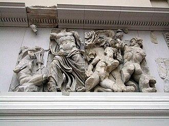 Porphyrion - Zeus (center left) against Porphyrion (far right), detail from the  Pergamon Altar Gigantomachy frieze, Pergamon Museum Berlin.