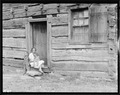 """Home of Alfred Bledsoe on Clear Creek Road near Loyston, Tennessee. This cabin is about one hundred years old."" - NARA - 532691.tif"