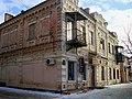 Вул. Богдана Хмельницького, 14, будинок, бокова стіна.jpg