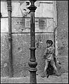 """Children In Naples, Italy"". Little boy smoking and pissing. Photographed by Lieutenant Wayne Miller, July 1944. U.S. Navy Photograph, now in the collections of the National Archives.jpg"