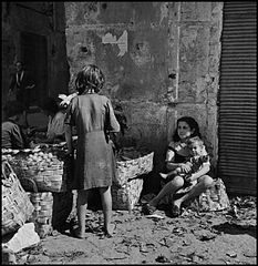 """Children In Naples, Italy"". Poor little girls. Photographed by Lieutenant Wayne Miller, July 1944. U.S. Navy Photograph, now in the collections of the National Archives.jpg"