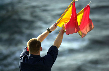 A naval signaler transmitting a message by flag semaphore (2002). 020118-N-6520M-011 Semaphore Flags.jpg