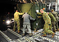 110324-F-AM028-453 RAAF C-17 unloading container at Sendai Airport.jpg