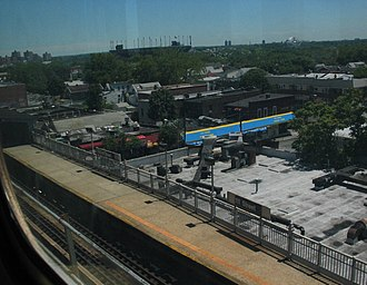 111th Street (IRT Flushing Line) - A view of the platform as seen from an express train on the flyover track.