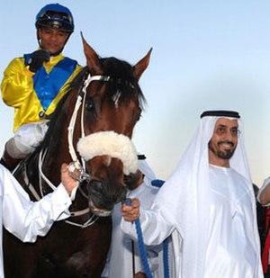 Mohammed bin Khalifa Al Maktoum - Sheikh Mohammed bin Khalifa Al Maktoum holding his horse, 2007 UAE triple crown winner Asiatic Boy