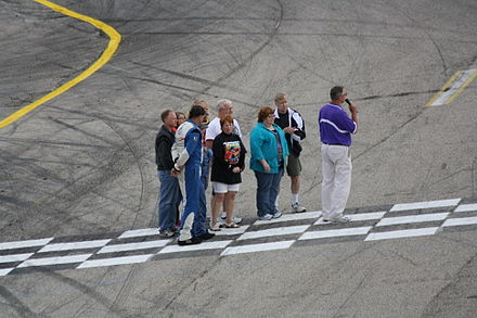 Trickle's family and Rich Bickle giving tribute at the 2013 Slinger Nationals 2013 Slinger Nationals Dick Trickle family along with Rich Bickle.jpg