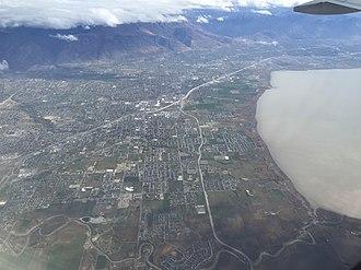 Utah County, Utah - View of the cities of Lehi, American Fork, Pleasant Grove, Lindon and Orem along Interstate 15 and the northeast shore of Utah Lake