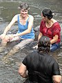 3 women bathing with clothes on in El Salvador.jpg