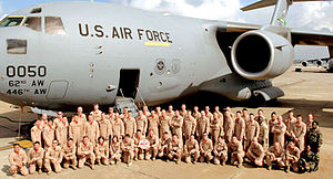 4th Airlift Squadron - 4th Airlift Squadron airmen pose in front of C-17A Globemaster III 98-0050 at Incirlik Air Base, Turkey, after finishing out a recent 120-day deployment.