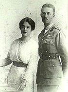 Half-length portrait of man in military uniform beside woman wearing white dress