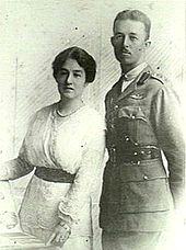 Half-length portrait of man in military uniform beside woman wearing white dress