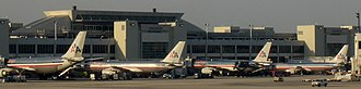 American Airlines - AA aircraft at Concourse D of Miami International Airport in April 2005.