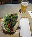 A Berlin style Döner with a glass of beer on side.jpg