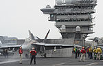 A U.S. Navy F-A-18E Super Hornet aircraft assigned to Strike Fighter Squadron (VFA) 147 prepares to launch from the flight deck of the aircraft carrier USS Nimitz (CVN 68) June 13, 2013, while operating in 130613-N-ZG290-174.jpg