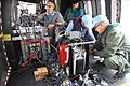 A multispectral and infrared imaging device being prepared and monitored for overflight. (15882024821).jpg
