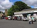 Across the Market place towards the Co-op and Parish Church of St Cuthbert - geograph.org.uk - 541910.jpg